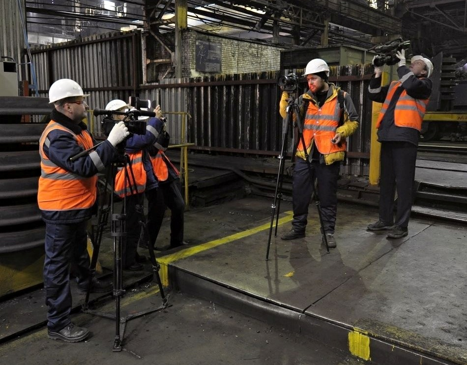 Surrounded by journalists at ural steel mill Evraz NTMZ